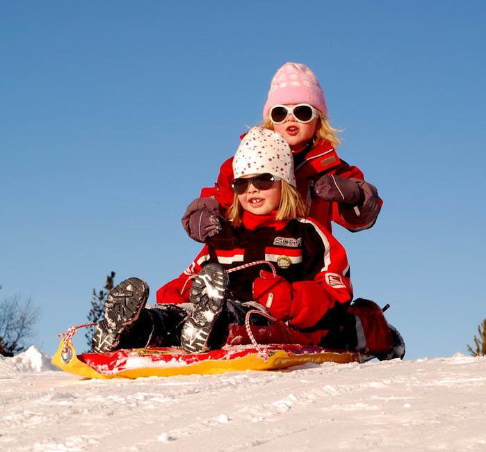 sweden-children-girls-sled-Skiing with kids